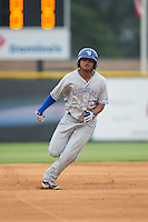 Deiferson Barreto (13) of the Bluefield Blue Jays hustles towards third base against the Burlington Royals at Burlington Athletic Park on July 1, 2015 in Burlington, North Carolina.  The Royals defeated the Blue Jays 5-4. (Brian Westerholt/Four Seam Images)
