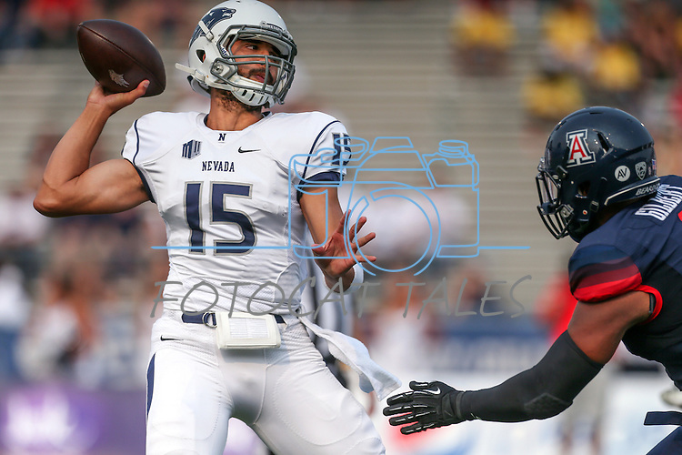 Arizona's Reggie Gilbert pressures Nevada quarterback Tyler Stewart during an NCAA college football game in Reno, Nev., on Saturday, Sept. 12, 2015.(AP Photo/Cathleen Allison)