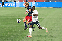 FOXBOROUGH, MA - OCTOBER 19: Scott Caldwell #6 of New England Revolution leaps to control the ball during a game between Philadelphia Union and New England Revolution at Gillette on October 19, 2020 in Foxborough, Massachusetts.