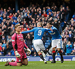 Harry Forrester scores the opening goal for Rangers and celebrates with Kenny Miller as Queens keeper Robbie Thomson is dejected