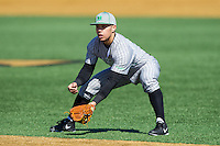 Marshall Thundering Herd second baseman Andrew Dundon (14) on defense against the Georgetown Hoyas at Wake Forest Baseball Park on February 15, 2014 in Winston-Salem, North Carolina.  The Thundering Herd defeated the Hoyas 5-1.  (Brian Westerholt/Four Seam Images)