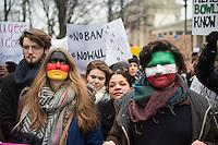 """Protest vor der US-Botschaft in Berlin gegen US-Praesident Donald Trump.<br /> Ca. 1500 Menschen demonstrierten am Samstag den 4. Februar 2017 in Berlin unter dem Motto """"End the Ban Now! Refugees and Immigrants are Welcome!"""" am Brandenburger Tor gegen US-Praesident Donald Trump und seine Plaene eine Mauer an der Grenze zu Mexiko bauen zu lassen. Die Demonstranten zogen vom Brandenburger Tor zur US-Botschaft.<br /> Im Bild: Eine Frau hat sich die Deutschlandfahne und ein Mann hat sich die iranische Fahne in das Gesicht gemalt.<br /> 4.4.2017, Berlin<br /> Copyright: Christian-Ditsch.de<br /> [Inhaltsveraendernde Manipulation des Fotos nur nach ausdruecklicher Genehmigung des Fotografen. Vereinbarungen ueber Abtretung von Persoenlichkeitsrechten/Model Release der abgebildeten Person/Personen liegen nicht vor. NO MODEL RELEASE! Nur fuer Redaktionelle Zwecke. Don't publish without copyright Christian-Ditsch.de, Veroeffentlichung nur mit Fotografennennung, sowie gegen Honorar, MwSt. und Beleg. Konto: I N G - D i B a, IBAN DE58500105175400192269, BIC INGDDEFFXXX, Kontakt: post@christian-ditsch.de<br /> Bei der Bearbeitung der Dateiinformationen darf die Urheberkennzeichnung in den EXIF- und  IPTC-Daten nicht entfernt werden, diese sind in digitalen Medien nach §95c UrhG rechtlich geschuetzt. Der Urhebervermerk wird gemaess §13 UrhG verlangt.]"""