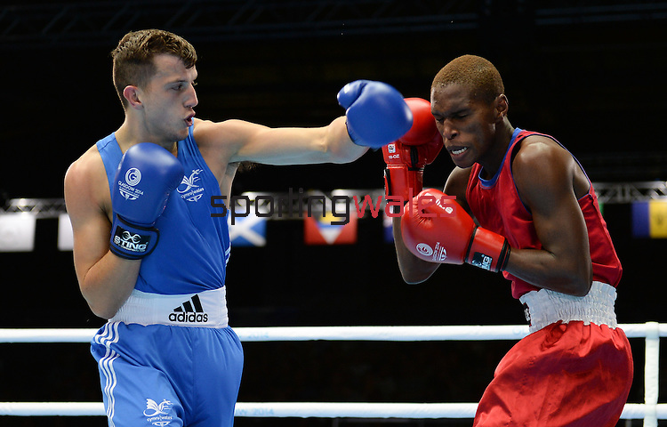 Wales Zach Davis in action against Thabiso Dlamini<br /> <br /> Photographer Ian Cook/Sportingwales<br /> <br /> 20th Commonwealth Games - Boxing -  Day 3 - Saturday 26th July 2014 - Glasgow - UK