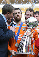 Houston captain Wade Barrett with Rob Stone of ESPN. The Houston Dynamo defeated the New England Revolution 2-1 in the finals of the MLS Cup at RFK Memorial Stadium in Washington, D. C., on November 18, 2007.