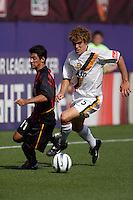 The MetroStars' Pablo Brenes looks to defend the Galaxy's Chris Albright. The LA Galaxy were defeated by the NY/NJ MetroStars 2 to 1 at Giant's Stadium, East Rutherford, NJ, on June 19, 2004.