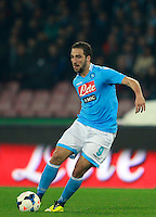 Calcio, Serie A: Napoli vs Juventus. Napoli, stadio San Paolo, 30 marzo 2014. <br /> Napoli forward Gonzalo Higuain, of Argentina, in action during the Italian Serie A football match between Napoli and Juventus at Naples' San Paolo stadium, 30 March 2014.<br /> UPDATE IMAGES PRESS/Isabella Bonotto