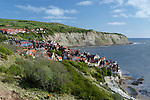 Great Britain, England, North Yorkshire, View over village of Robin Hood`s Bay, start of the coast to coast walk