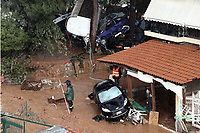Pictured: Debris and cars in the middle of the road.<br /> Re: Five people have reportedly died and severe damage caused by heavy rain and flash flooding in the area of Mandra, near Athens, Greece. Wednesday 15 November 2017