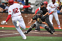 Bristol Pirates catcher Jason Delay (14) fields the ball and prepares to tag out Jonathan Rivera (52) as home plate umpire Josh Gilreath prepares to make a call during a game against the Johnson City Cardinals at TVA Credit Union Ballpark on June 23, 2017 in Johnson City, Tennessee. The Pirates defeated the Cardinals 4-3. (Tony Farlow/Four Seam Images)
