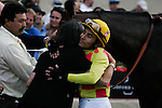 Rafael Bejarano and trainer Alexis Barba in the winner circle for Unusual Heatwave winner of the Real Good Deal Stakes at Del Mar Race Course in Del Mar, California on August 3, 2012.