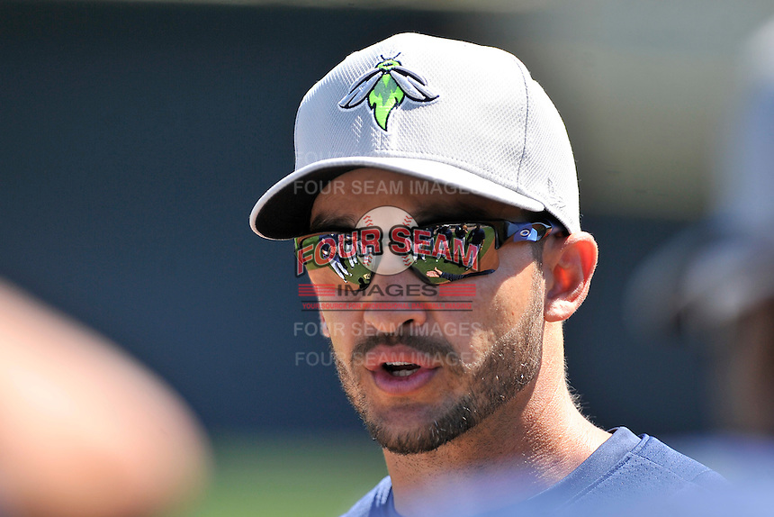 Manager Jose Leger (19) of the Columbia Fireflies talks to his team on Sunday, April 3, 2016, their first day at the new Spirit Communications Park in Columbia, South Carolina. The Class A South Atlantic League Mets affiliate moved here this year from Savannah. (Tom Priddy/Four Seam Images)