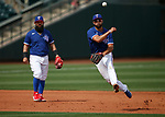 Isiah Kiner-Falefa makes a play during a spring training game between the Texas Rangers and Los Angeles Dodgers in Surprise, Ariz., on Sunday, March 7, 2021.<br /> Photo by Cathleen Allison