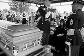 Tucson, Arizona.USA.March 16, 2007..At the Evergreen Cemetery Lori Kasson (center), the widow and the mother Sharon Jones (far left) of Staff Sgt. Darrel D. Kasson, 43, of Florence, Arizona at the funeral services. He died March 4 in Tikrit, Iraq, of wounds suffered when an improvised explosive device detonated near his vehicle at Bayji, Iraq. He was assigned to the 259th Security Forces Company, Phoenix.
