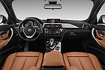 Stock photo of straight dashboard view of 2018 BMW 3-Series 330i-Sports-Wagon 5 Door Wagon Dashboard