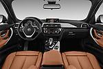 Stock photo of straight dashboard view of 2018 BMW 3-Series 330i-Sports-Wagon 5 Door Wagon Dashboard