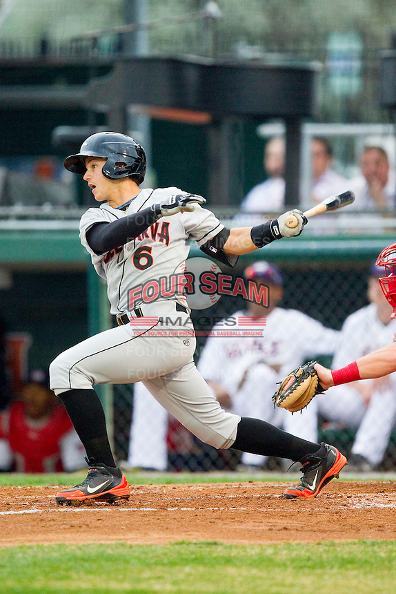 Adrian Marin (6) of the Delmarva Shorebirds follows through on his swing against the Hagerstown Suns at Municipal Stadium on April 11, 2013 in Hagerstown, Maryland.  The Shorebirds defeated the Suns 7-4 in 10 innings.  (Brian Westerholt/Four Seam Images)