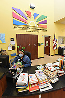 Odalys Pineda (cq) staffs the front desk on Wednesday March 17 2021 at the Benton County Sunshine School and Development Center in Rogers.<br />
