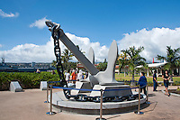 Visitors walk around an anchor on display at the Pearl Harbor Museum complex, Pearl Harbor, O'ahu.