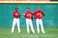 (L-R) Lewis Brinson (25), Nomar Mazara (12) and Jairo Beras (32) of the Hickory Crawdads hang out during  pitching change in the South Atlantic League game against the Asheville Tourists at L.P. Frans Stadium on April 13, 2014 in Hickory, North Carolina.  The Tourists defeated the Crawdads 5-4.  (Brian Westerholt/Four Seam Images)