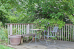 Secluded tea table at Oregon Gardens.  Oregon Gardens, Silverton, Oregon, USA, an 80 acre botanical garden in the Willamette Valley.  Windy day.