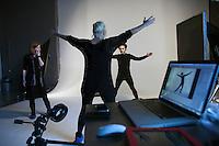 Moscow, Russia, 11/02/2011..Producer Elena Kashirskaya and photographer direct Snob magazine journalist Ilya Kolmonovski during studio shoot in which Kolmonovski enacts parts of the human body.