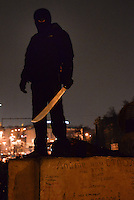 A supporter of Euromiadan celebrates the Yanukovich ouster holding a machete