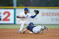 Burlington Royals shortstop Maikel Garcia (2) receives a pick off throw as Ryder Green (21) of the Pulaski Yankees dives head first into second base at Burlington Athletic Stadium on August 25, 2019 in Burlington, North Carolina. The Yankees defeated the Royals 3-0. (Brian Westerholt/Four Seam Images)