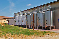 Outside fermentation tanks in stainless steel and in painted steel  Chateau de Haux Premieres Cotes de Bordeaux  Entre-deux-Mers  Bordeaux Gironde Aquitaine France