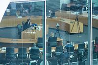 """Letzte Sitzung des Untersuchungsausschusses """"PKW-Maut"""" des Deutschen Bundestag am Donnerstag den 28. Februar 2021.<br /> Als einziger Zeuge war erneut Bundesverkehrsminister Andreas Scheuer, CSU, vorgeladen.<br /> Der Ausschuss wurde zur Aufklaerung der Mautvertraege zwischen dem Verkehrsministerium unter Leitung von Andreas Scheuer und den Firmen Kapsch und CTS Eventim eingerichtet.<br /> Der Maut-Untersuchungsausschuss soll das Verhalten der Regierung und besonders des Verkehrsministers bei der Vorbereitung und der Vergabe der Betreibervertraege """"umfassend aufklaeren"""".<br /> Verkehrsminister Scheuer betonte vor der Sitzung wiederholt, dass alles mit rechten Dingen zugegangen sei.<br /> Im Bild: Der Ausschuss vernimmt Verkehrsminister Scheuer (Links am Tisch).<br /> 28.1.2021, Berlin<br /> Copyright: Christian-Ditsch.de"""