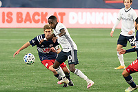 FOXBOROUGH, MA - OCTOBER 19: Jamiro Monteiro #10 of Philadelphia Union brings the ball forward as Scott Caldwell #6 of New England Revolution comes in to tackle during a game between Philadelphia Union and New England Revolution at Gillette on October 19, 2020 in Foxborough, Massachusetts.