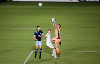 CARSON, CA - MARCH 07: GK David Bingham #1 of the Los Angeles Galaxy making a save in the box with team mate Nick DePuy #20 defending against Jasser Khmiri #20 of the Vancouver Whitecaps during a game between Vancouver Whitecaps and Los Angeles Galaxy at Dignity Health Sports Park on March 07, 2020 in Carson, California.
