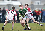 Eoin Rouine of  Ennistymon CBS  in action against Donal Queally and James Power of  St Declan's Kilmacthomas during their Munster C Colleges football final at Rathkeale. Photograph by John Kelly.