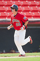 Matt West #22 of the Hickory Crawdads heads towards home plate after hitting a home run against the Greensboro Grasshoppers at  L.P. Frans Stadium July 10, 2010, in Hickory, North Carolina.  Photo by Brian Westerholt / Four Seam Images