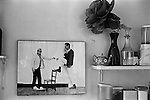 Patrick Procktor artist London 1969. Photograph on wall of kitchen David Hockney + PP. His kitchen in his Manchester Street flat London. 1999