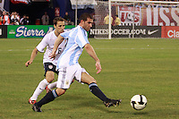 Argentina forward Lisandro Lopez (19) and United States defender Steve Cherundolo (6). The men's national teams of the United States and Argentina played to a 0-0 tie during an international friendly at Giants Stadium in East Rutherford, NJ, on June 8, 2008.