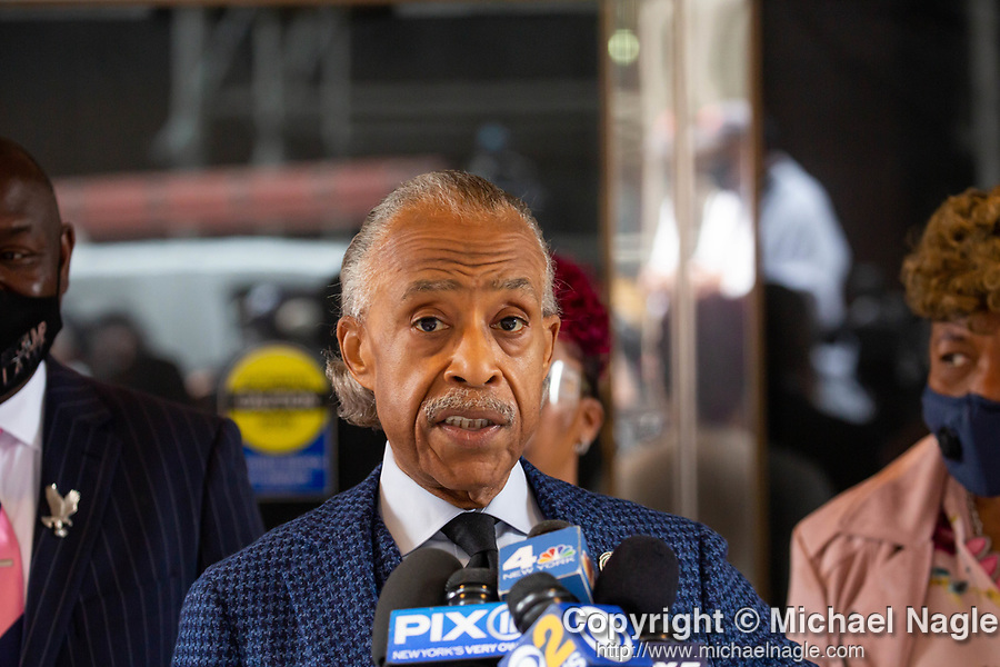 """Reverend Al Sharpton, center, speaks at a press conference in response to the George Floyd and Duante Wright cases along with Benjamin Crump, attorney for the Wright family, left, and Gwen Carr, mother of Eric Garner, right, after the """"Mother's of the Movement"""" panel at the National Action Network (NAN) Virtual Convention 2021 in New York on Wednesday, April 14, 2021. Photograph by Michael Nagle"""