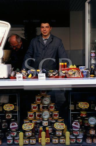 Sofia, Bulgaria. Man selling fresh and tinned fish.
