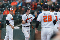 Oregon State Beavers left fielder Joe Casey (6) is congratulated by teammates after scoring a run during a game against the New Mexico Lobos on February 15, 2019 at Surprise Stadium in Surprise, Arizona. Oregon State defeated New Mexico 6-5. (Zachary Lucy/Four Seam Images)