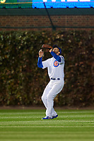 Chicago Cubs left fielder Ben Zobrist (18) settles under a fly ball in the fourth inning during Game 5 of the Major League Baseball World Series against the Cleveland Indians on October 30, 2016 at Wrigley Field in Chicago, Illinois.  (Mike Janes/Four Seam Images)