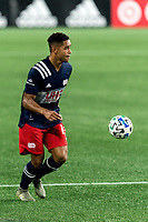 FOXBOROUGH, MA - AUGUST 29: Brandon Bye #15 of New England Revolution brings the ball forward during a game between New York Red Bulls and New England Revolution at Gillette Stadium on August 29, 2020 in Foxborough, Massachusetts.