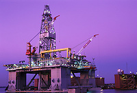 semisubmersible oil drilling rig under construction at dusk