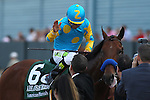 April 11, 2015: American Pharoah with jockey Victor Espinoza aboard celebrating with co-trainer Jimmy Barnes after winning the Arkansas Derby at Oaklawn Park in Hot Springs, AR. Justin Manning/ESW/CSM