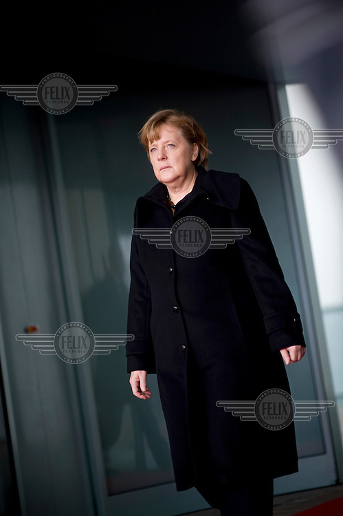 DEU, Deutschland, Germany, Berlin, 30.01.2013.German Chancellor Angela Merkel waiting for the egypt premier minister at the entrance of the Chancellery in Berlin, Germany. International Politics, Germany, Europe, Politican, Portrait, 2013.