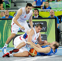 "Vasilije Micic and Nemanja Bjelica of Serbia fights for the ball with Italy`s Marco Cusin during European basketball championship ""Eurobasket 2013""  basketball game for 7th place between Serbia and Italy in Stozice Arena in Ljubljana, Slovenia, on September 21. 2013. (credit: Pedja Milosavljevic  / thepedja@gmail.com / +381641260959)"