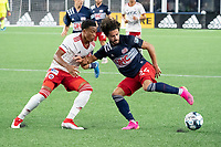 FOXBOROUGH, MA - JUNE 26: Collin Smith #32 of North Texas SC pressures Ryan Spaulding #34 of the New England Revolution during a game between North Texas SC and New England Revolution II at Gillette Stadium on June 26, 2021 in Foxborough, Massachusetts.