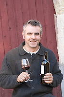 Christophe Bousquet Chateau Pech-Redon. La Clape. Languedoc. Owner winemaker. France. Europe. Bottle.