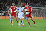 UEFA European Championship at Cardiff City Stadium - Wales v Cyprus : <br /> Hal Robson-Kanu of Wales and Marios Antoniades of Cyprus tussle for the ball.