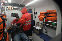 An injured  demonstrator is being treated  inside the   ambulance  during the  violent protest against new draconian law to ban protestsacross the country.  Kiev. Ukraine
