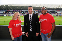 Letou CEO Paul Fox (C) with Sheter Cymru Charity during the English Premier League soccer match between Swansea City and Manchester United at Liberty Stadium, Swansea, Wales, UK. Saturday 18 August 2017