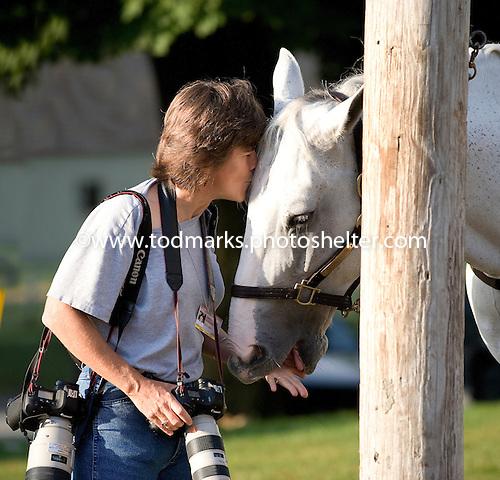 Photographer Barbara Livingston nuzzles Poncho, Steve Asmussen's stable pony